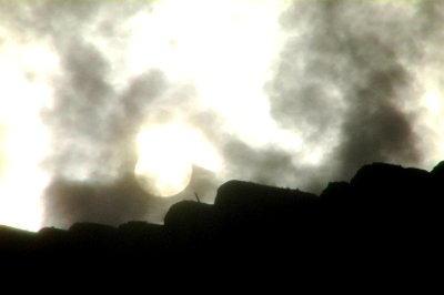 stock-footage-sun-shines-through-rising-steam-at-a-lumberyard